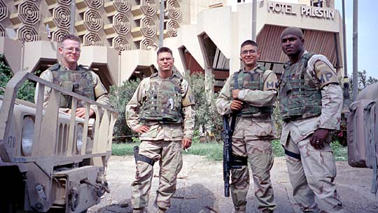 Four US soldiers pose for camera