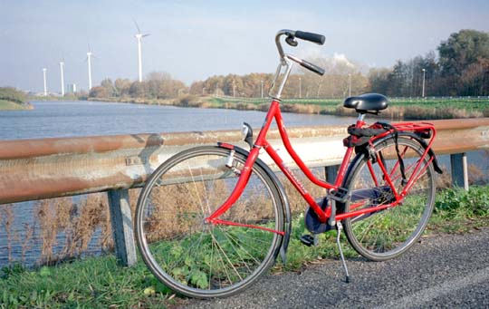 Red bicycle in Netherland fields