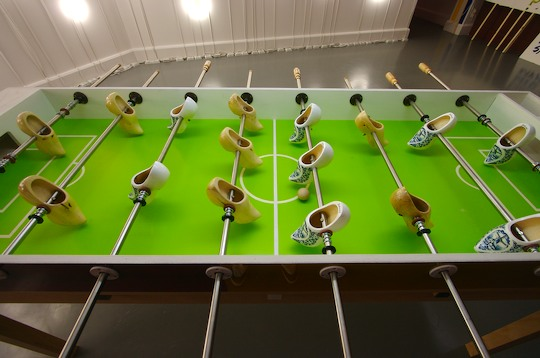 Fussball table using wooden clogs instead of small men
