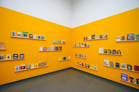 Yellow walls displaying books