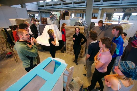 Design students stand around in the studio making decisions