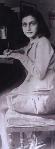 Anne Frank writing at her desk