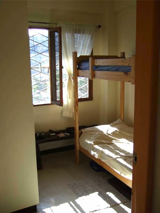 A bunkbed and a closet