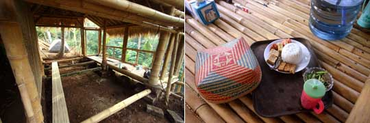 View of inside of unfinished bamboo home and tray with breakfast on floor
