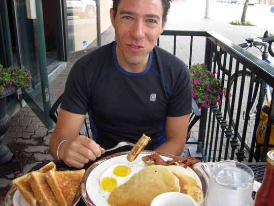Man eating breakfast at a restaurant