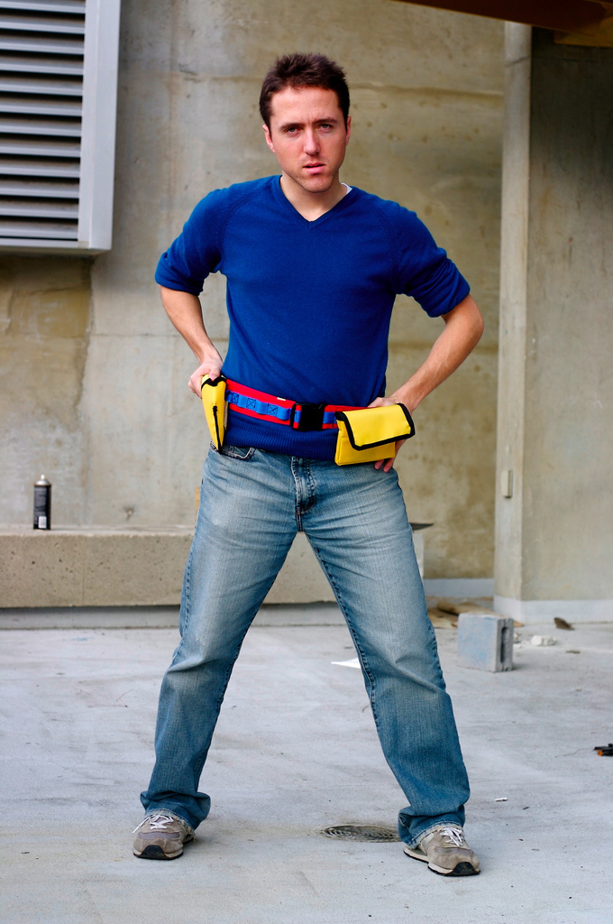 Man wearing yellow belt with puches and holsters