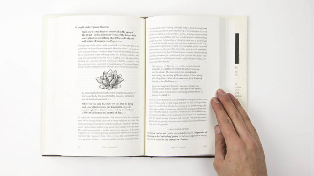 Interior spread of hard cover book showing illustration of lotus flower and text
